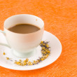 Coffee on orange background - Foto Stock