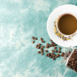 Stock Photo: Coffee and beans on retro background