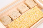 Handmade soap in wooden box as gift — Stock Photo