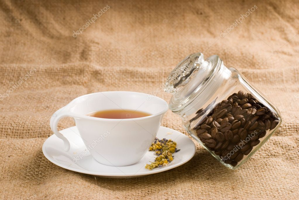 Tea and glass coffee jar with burlap background — Stock Photo #2335198
