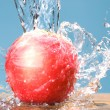 Frozen splash and rose color apple — Stock Photo