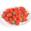 Isolated pile strawberry in white dish — Stock Photo #2564023
