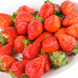 Isolated pile strawberry in white dish — Stock Photo