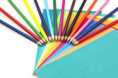 Colorful pencils and papers — Stock Photo
