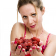 Woman with raspberries — Stock Photo