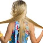 Long hair blonde woman braids one's hair — Stock Photo #1820838