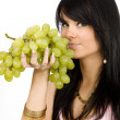 Brunette with bunch of grapes — Stock Photo #1832423