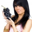Brunette with black grapes — Stock Photo #1832432