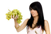 Brunette with bunch of grapes — Stock Photo