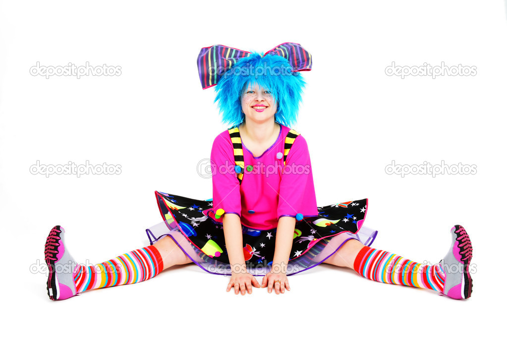 Funny smiling clown with blue hair in bright cloth — Stock Photo #1834468