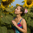 Woman with sunflower — Stock Photo