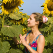 Woman with sunflower — Stock Photo #1845154