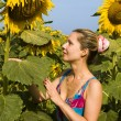 Womwith sunflower — Stock Photo #1845154