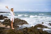 Blonde at coastline — Stock Photo