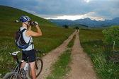 Beautifully landscape and biker — Stock Photo