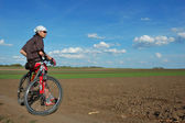 Beautifully landscape with one biker — Stock Photo
