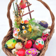 Stock Photo: Easter basket with colored eggs