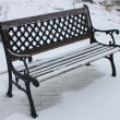 Snow-Covered Benches. - Stock Photo