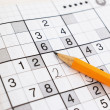 Close up of sudoku game and yellow penci - Stock Photo