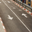 Stock Photo: Road with white line and arrows