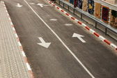 Road with white line and arrows — Stock Photo