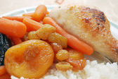 Stewed carrots with rice and chicken — Stock Photo