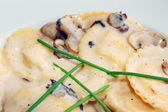 Mushroom ravioli with cream sauce — Stock Photo