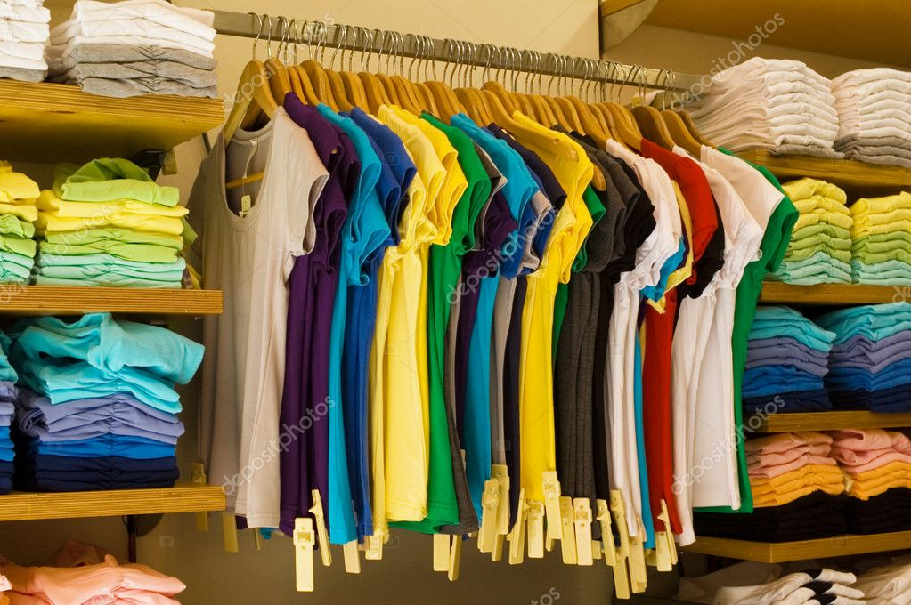 A colored shirts at the clothes shop — Stock Photo #1808631