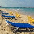 Stock Photo: Sunbeds and chairs on beach