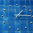 Clock on wall of office building — Stock Photo