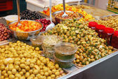 Assortment of olives, pickles and salads — Stock Photo