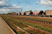 Railroad tracks and freight train — Stock Photo