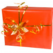 Red gift box with golden ribbon — Stock Photo #2537269