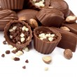 Assorted chocolate candies and nuts - Stock Photo