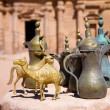 Brass jugs and animal figurines in Petra — Stock Photo #1764912