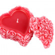 Heart-shaped wax candle with roses — Stock Photo