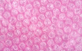 Pink bubble wrap sheet — Stock Photo