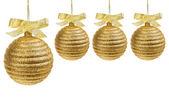 Cuatro bolas de navidad oro — Foto de Stock