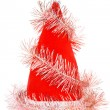 Santa's red hat with pink tinsel — Stock Photo