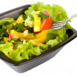 Bowl of fresh salad and fork - Stock Photo