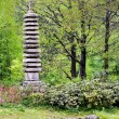 Granite pagoda in japanese garden - Foto Stock