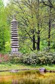 Granite pagoda in japanese garden — Stock Photo