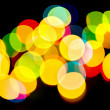 Multicolored defocused holiday lights — Stock Photo