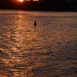 Buoy in lake over sunset — Stock Photo