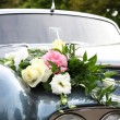 Wedding car decorated with flowers — Stock Photo #1756419