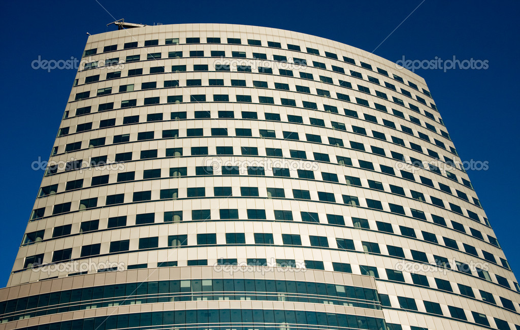 New skyscraper over dark blue sky — Stock Photo #1839693