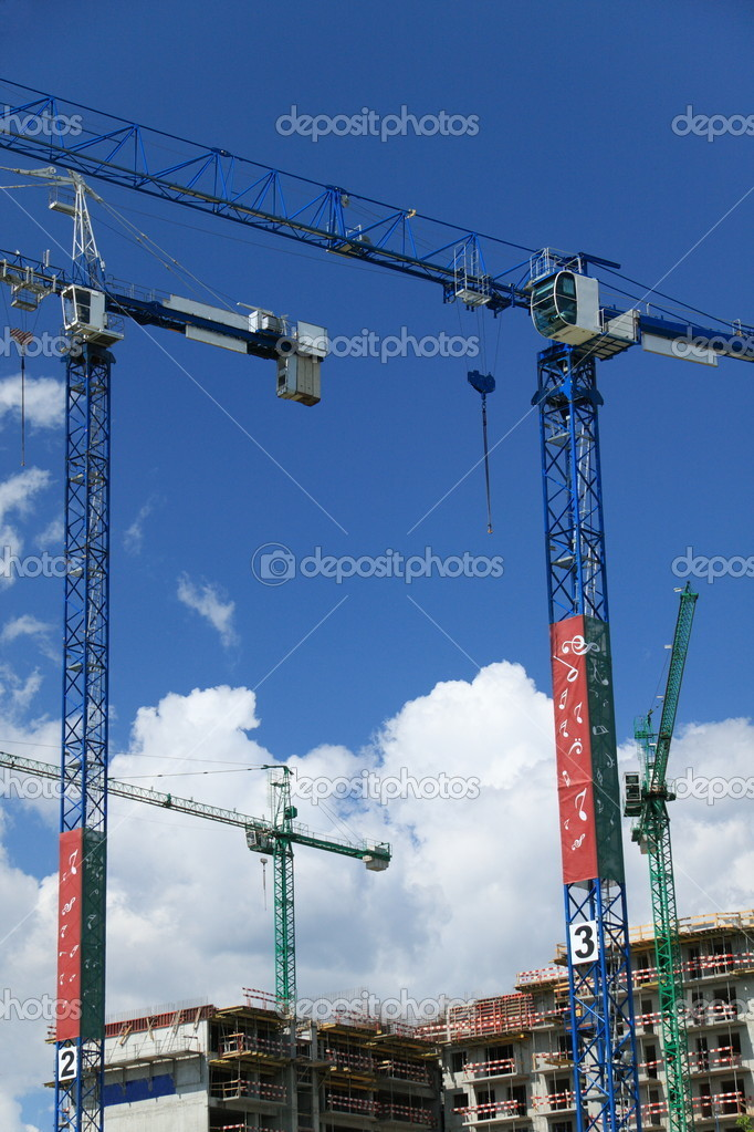 Contruction cranes over blue sky — Stock Photo #1839898