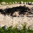 Ring of stones around campfire — Stock Photo