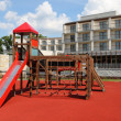 Playground in a front of modern building — Stock Photo