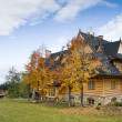 Traditional hooden house in moutains - Stock Photo